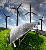 Solar energy panels and wind turbine. In the sunset Stock Images