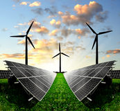 Solar energy panels and wind turbine. In the sunset Stock Photography