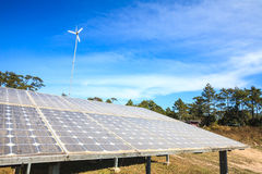 Solar energy. Panels and wind turbine Stock Images