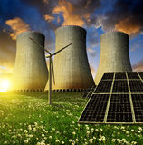 Solar energy panels, wind turbine and nuclear power plant Stock Photos