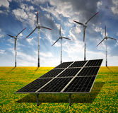 Solar energy panels and wind turbine Royalty Free Stock Images