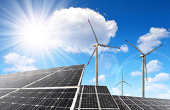 Solar energy panels and wind turbines. Stock Images