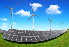 Solar energy panels and wind turbines. Stock Photos