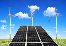Solar energy panels and wind turbines. Stock Image