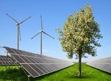 Solar energy panels with wind turbines Stock Photo