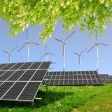 Solar energy panels with wind turbines. Stock Image