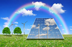 Solar energy panels and wind turbines. On meadow Royalty Free Stock Photo