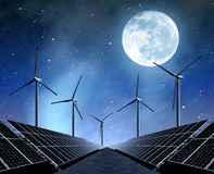 Solar energy panels and wind turbines Stock Images