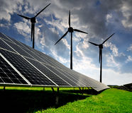 Solar energy panels with wind turbines Royalty Free Stock Photo