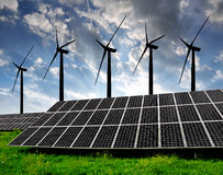 Solar energy panels with wind turbines Stock Image