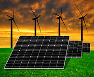 Solar energy panels with wind turbines. In the setting sun royalty free stock photos