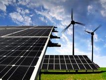 Solar energy panels with wind turbines Stock Photos
