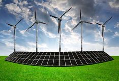 Solar energy panels with wind turbines Royalty Free Stock Photos