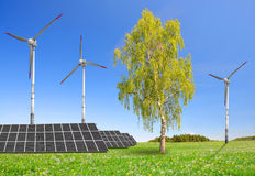 Solar energy panels and wind turbines Royalty Free Stock Images