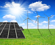 Solar energy panels and wind turbines. Spring meadow with solar energy panels and wind turbines Stock Images