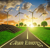 Solar energy panels and wind turbines at sunset. Royalty Free Stock Photo