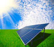 Solar energy for sustainable development of Green meadow Stock Photos