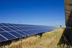 Solar Farm. Solar power plant against a deep blue sky Royalty Free Stock Photography