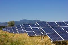 Solar Farm. Solar power plant against a mountain landscape Stock Images