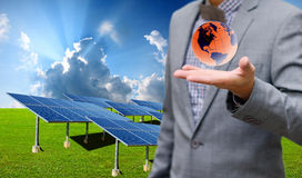 Solar farm with businessman carry virtual world Stock Photos