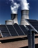 Solar farm and cooling towers Royalty Free Stock Photo