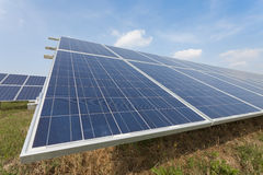 Solar Farm in the Countryside. Modern solar panels in a beautiful green field Royalty Free Stock Photos