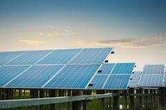 Solar farm at dusk. Solar power plant at dusk, clean energy concept Royalty Free Stock Image
