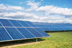 Solar Farm Park. Panels In Green Field With Blue Sky& Nature Royalty Free Stock Photography