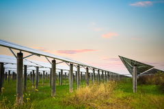 Solar farm with sunset glow Royalty Free Stock Photography