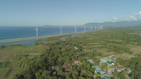 Solar Farm with Windmills. Philippines, Luzon. Aerial view of Windmills for electric power production on the seashore. Bangui Windmills in Ilocos Norte stock footage