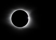 Solar flare and diamond ring around eclipse royalty free stock images