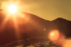 Solar flare on snowy slopes Royalty Free Stock Photos