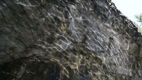 The solar flares on the marble wall in the cave stock footage
