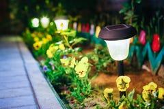 Solar Garden Light, Lanterns In Flower Bed. Garden Solar Powered Royalty Free Stock Photography