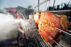 Solar-gegrilltes Schweinefleisch von einem Glas Stockfoto