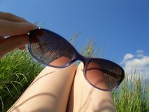 Solar glasses and sky Royalty Free Stock Photography