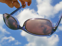 Solar glasses and sky Royalty Free Stock Photo