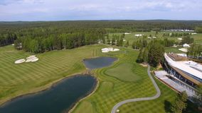 Solar Golf cart with clouds on blue sky and forest lake Golf club, aerial.  Royalty Free Stock Image