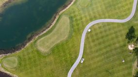 Solar Golf cart with clouds on blue sky and forest lake Golf club, aerial.  Stock Images