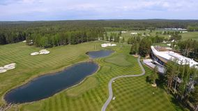 Solar Golf cart with clouds on blue sky and forest lake Golf club, aerial.  Stock Photo