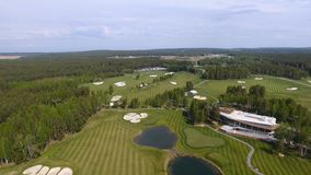 Solar Golf cart with clouds on blue sky and forest lake Golf club, aerial.  Stock Photography