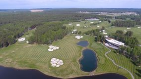 Solar Golf cart with clouds on blue sky and forest lake Golf club, aerial.  Stock Image