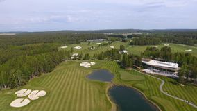 Solar Golf cart with clouds on blue sky and forest lake Golf club, aerial.  Stock Photos