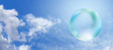 Solar Green Bubble on blue sky banner. Wide blue sky and fluffy clouds background with a transparent green bubble on right hand side Stock Images