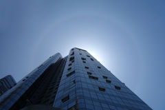 Solar halo with modern building. Modern building with solar halo  under blue sky in China Stock Photo