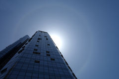 Solar halo with modern buildings. Modern building with solar halo  under blue sky in China Stock Photography