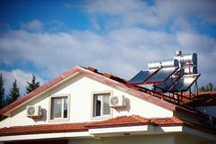 Solar heaters on the roof of the house. Against blue sky Royalty Free Stock Images