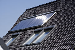 Solar heating panel on roof. Of residential house, sun brightly reflected Royalty Free Stock Photos