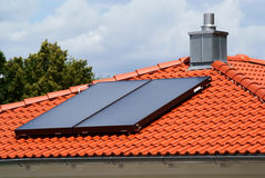 Solar heating system. A solar heating system on the roof of a house stock photo
