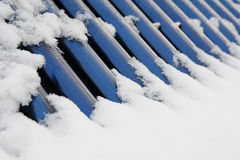 Solar heating under the snow cover. Blue bars of a solar heating system under the snow cover royalty free stock photos